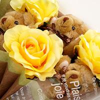 くま束(チビ束):ショコラ(黄色のバラの造花3本付き)の写真