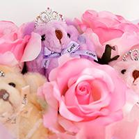 くま束(チビ束):セシル(ピンク色のバラの造花3本付き)の写真